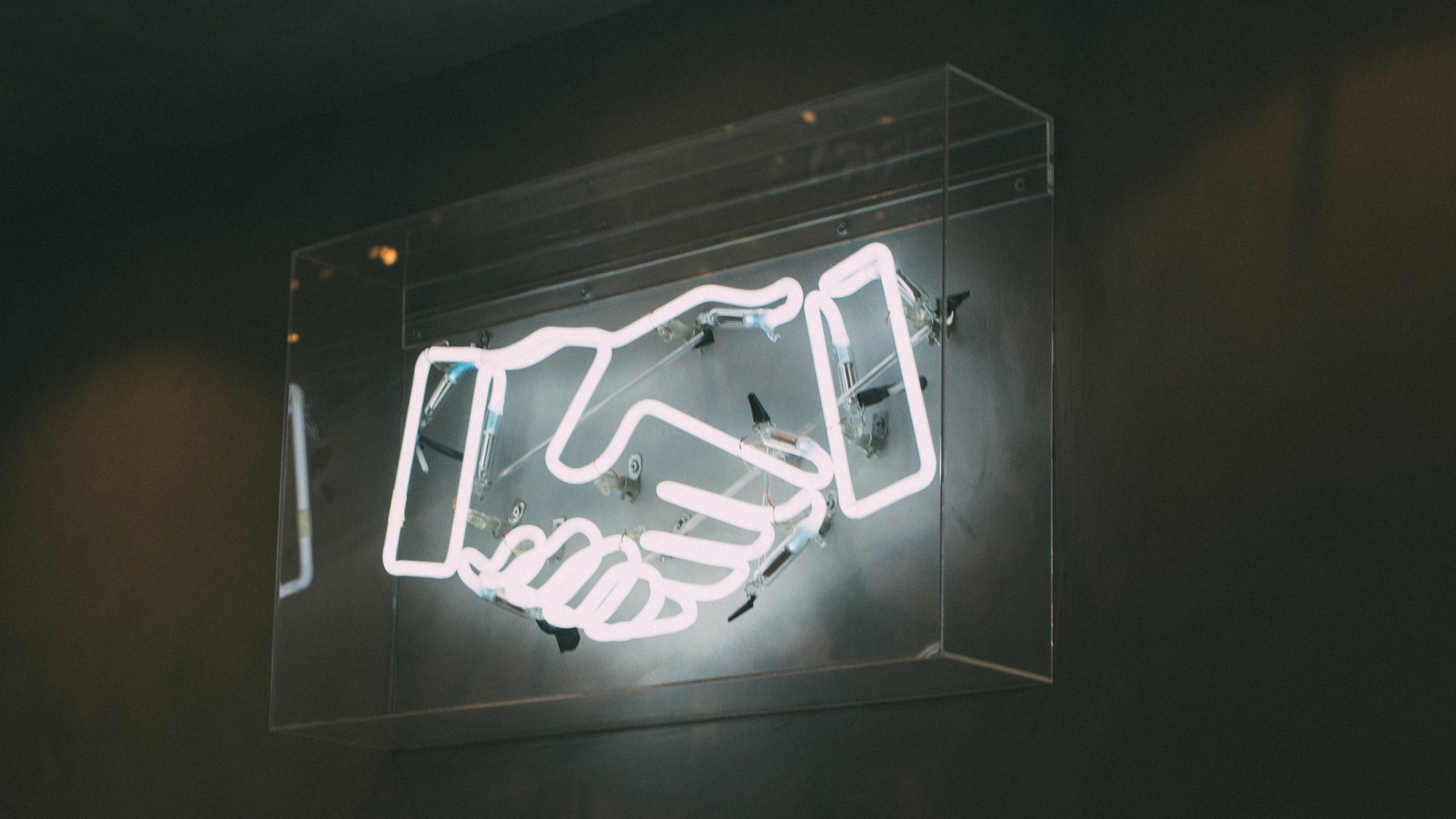 neon hand shake